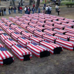caskets draped in US flags